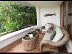 Enjoy the best of two worlds with both ocean and rainforest views from the living area balcony