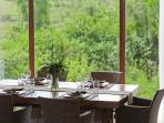Enjoy the dining by our floor to ceiling panoramic windows.
