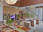 View from dining to spacious sofa space and TV with home theatre sound system and HD TV channels.