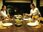 Ketut and Kadek serving dinner