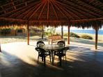 eat and lounge under our palapa patio