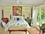 Melt into your Master bed and enjoy the gardens out the wonderful french doors!