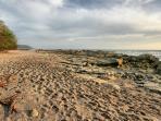Walking along Santa Teresa's white sand beach.