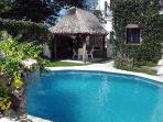 Lush tropical garden surrounds the private pool