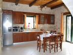 Kitchen and dinning area of villa Antonia