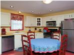 Redbird dining and kitchen area of great room - coffee maker, dishwasher, refrigerator/freezer show