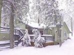 Wintertime at the Getaway Chalet. 2 decks out front. Back patio. Outdoor dining sets all three decks