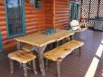 Rustic dining table on rear porch