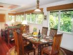 The Riverhouse dining area is just off the living room. Antique table and Koa chairs.
