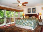 The Riverhouse master bedroom has a 1930's solid curly maple bedroom set.
