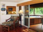 Lanai, Riverhouse - Hot tub, living view through to Kitchen beyond.