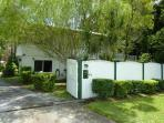 Main gate - fully fenced property with tropical gardens
