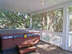 Private back deck with hot tub. Located off Living Room/Great Room