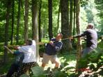 Wintergreen team tug of war on our front property.   3 Swings are set among the trees.