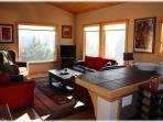 Open kitchen, living room and dining room with gorgeous views all around