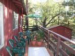 Great outdoor deck in the trees with table and chairs