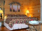 comfortable king bed in secluded TN cabin rental