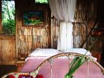 Indigo Tree cottage the bed