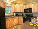 The kitchen has a big island and is fully equipped.