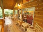 Relax on the covered deck and listen to the river.