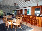 The spacious dining area comfortably seats 6 and flows into the rest of the great room/sitting area.