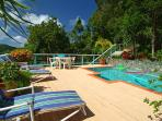 The pool deck is spacious and furnished with comfortable lounge chairs and total privacy.