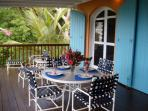 Dine al fresco on the covered deck and enjoy the impressive harbor and tropical views.