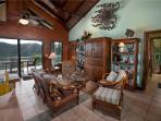 The main living area features a mahogany entertainment center and comfortable furniture.