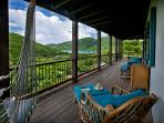 Enjoy the view of Coral Bay from the covered upper deck
