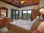The Master Bedroom is furnished with a comfortable pillow top queen sized bed with views to the east