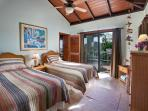 The second bedroom features 2 pillow top twins that convert into a king sized bed.