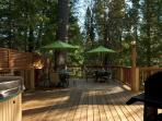 Huge deck with enclosed tree, overlooking creek, 2 tables each seats six