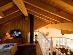 With its sloping wooden ceilings and extensive paneling