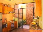 Kitchen and Back Garden with River Rock Waterwall