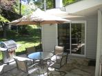 Flagstone Patio with Gas Grill, Umbrella, Table and 4 Chairs