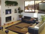 Living room has hand made wool carpet, Italian leather sofas, surround sound stereo and flat screen video.
