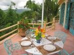 Outside dining on terrace with view of pool