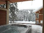 Private hot tub on outdoor patio with view on Mt Morrisey. Sits 5.