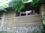 Part of the front view of the log cabin