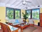 The Upper Level living room has comfy queen sleeper and casual Carribean inspired decor