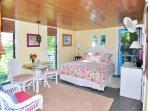 The Lower Level is a Comfortable and Charming Retreat w/ Stained Glass windows over Queen Bed