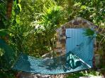 Enjoy the balmy breezes plus sights and sounds of our tropical garden from the Lower Level hammock