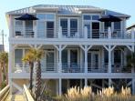 Beach facing side of home, balcony at top provides dual umbrella areas
