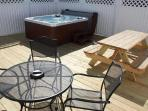 400 sq ft private rear deck with 6 person hot tub and seating for 10