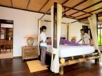 Villa Santai Ubud Villa Bedroom 3 with View of Closet in Backgroundwith Staff Turning down Bed