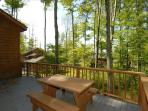 Wooded yard provides shade and privacy.