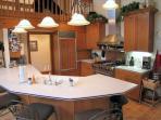 Upscale kitchen features Viking and SubZero appliances.