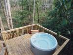 the hot tub deck located on the back of the cabin