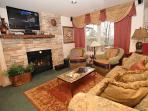 Living area with fireplace & T.V with custom decor