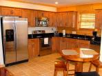 Our gourmet kitchen features granite counters, stainless appliances and ceramic tile throughout.